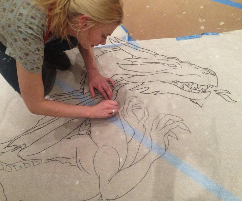 tracing the Draco constellation with charcoal