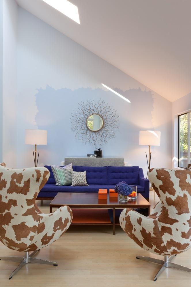 A salon in Robin's Egg blue, deep violet, and Hermes orange