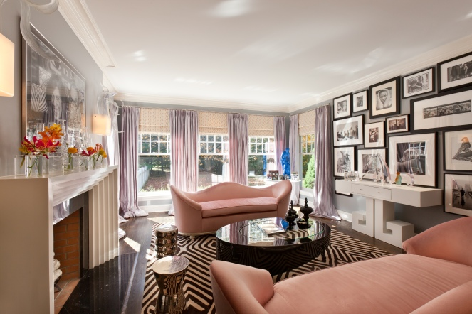 Pink and zebra elegant living room with salon-style art composition. Designed by Guillaume Gentet.